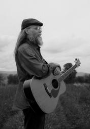 Matt Meighan bw with guitar