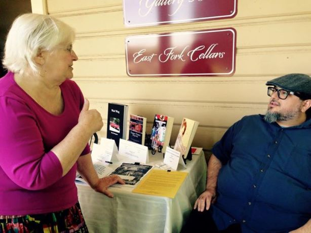 Peggy and Christopher at Gallery 360 Book Fair by Maureen Andrade